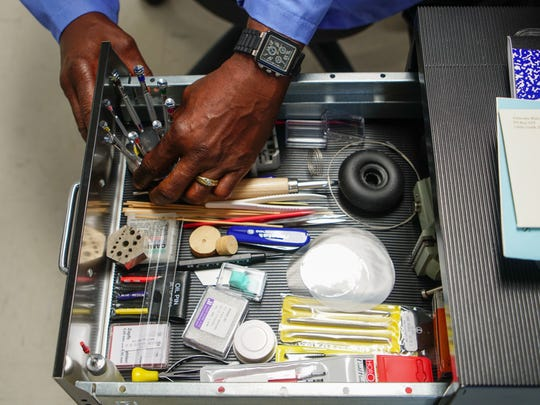 Lynn Gipson, of Middleton, an Army veteran, goes through the various tools he will be using to learn how to repair watches at the Veterans Watchmaker Initiative in Odessa.