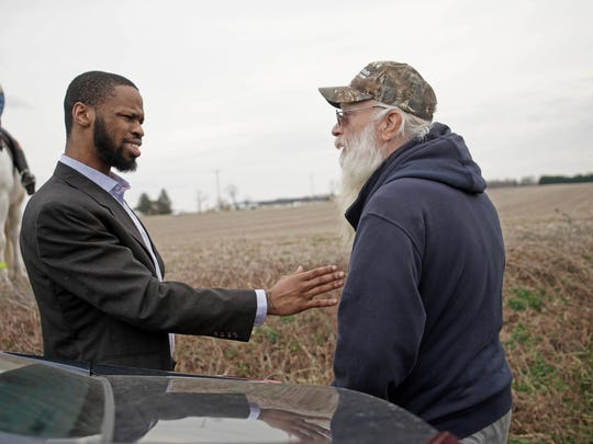 A supporter of inmates, Isaiah McCoy, 29, who served seven years at James T. Vaughn Correctional Center, confronts a supporter of guards at a protest along Paddock Road near the Smyrna-area prison during a violent riot there earlier this year.