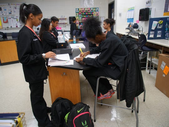 (left to right)Najzhay Fareed, 16, and Kyasia Guy-Wright, 16, both juniors in Delcastle Technical High School's dental assisting program work on class assignments.