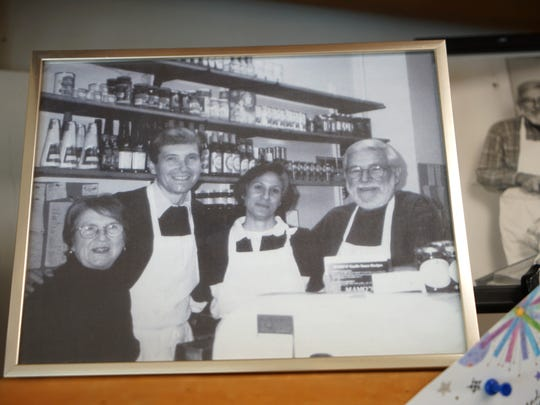 Family photograph of (left to right) Jeanette Herman with her son Timothy and his wife Christine next to Timothy's father Luther Herman, who started Herman's Quality Meats in Newark 50 years ago.