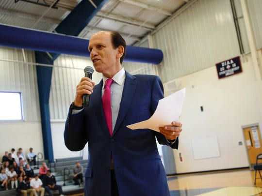 Mike Milken speaks at a Newark Charter School assembly before announcing the recipient of the $25,000 Milken Educator Award.