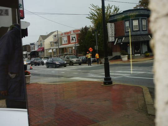 Road crews work on painting cross walks along Union Street.