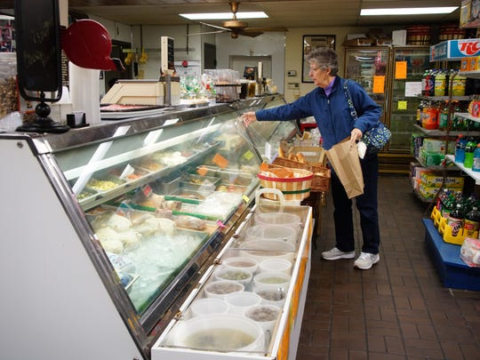 A customer shops at Papa's Food Market, an institution in Wilmington's Little Italy neighborhood.