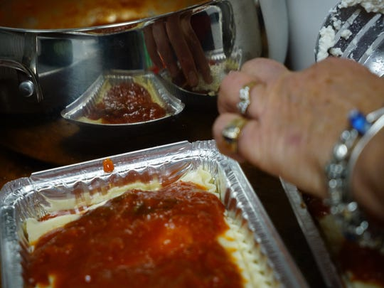 Papa's Food Market owner Rosemarie Papa continues to make her fresh lasagnas for customers in the Little Italy business.