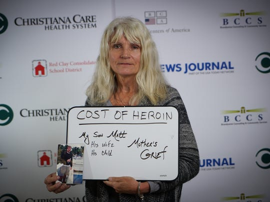 Attendee Mary Beth Cichocki of the Imagine Delaware: What Heroin Costs Delaware forum held at John Dickinson High School Monday night share their message of what heroin has cost them personally.