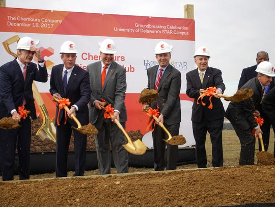 Officials shovel celebrate the naming of Chemours new