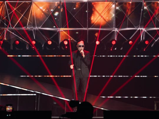 Pitbull performs at the American Bank Center Nov. 19,