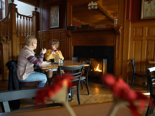 (Left to right) Detta Burcat and Cindy Moore enjoy breakfast and coffee by the fireplace at Govenor's Cafe in Dover during a morning meet-up.