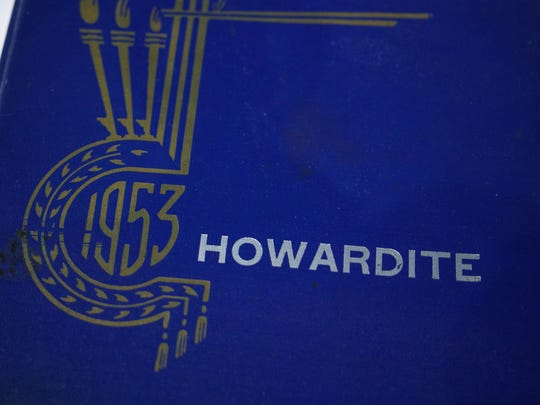 A Howard High Class of 1953 yearbook sits on table a reunion luncheon.