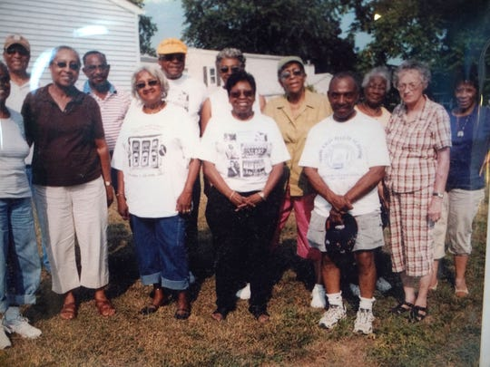 A photograph of 1953 Howard High graduates from past reunions.