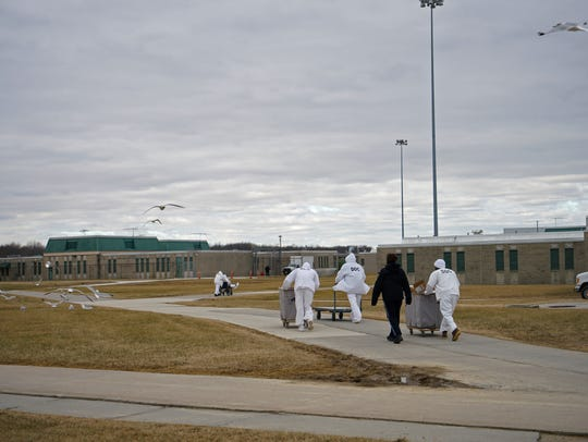 Inmates move between buildings at James T. Vaughn Correctional Center near Smyrna.