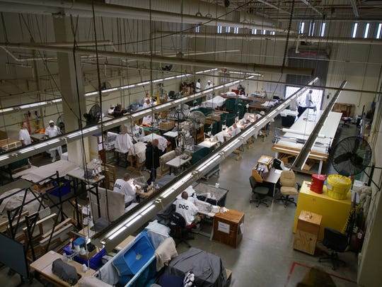 Inmates at James T. Vaughn Correctional Center work in the garment program at the prison.
