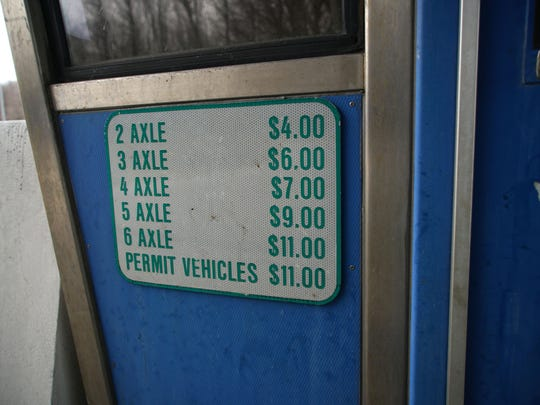 Toll fees posted on a toll booth at the I-95 Newark toll plaza.