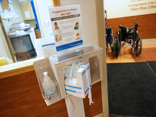 Flu prevention stations are placed around the emergency room at St. Francis Hospital to prevent the spread of the virus.