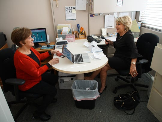 """Longtime stylist Arlene Corrigan, nicknamed """"Munchie,"""" visits with salon owner Maureen Freebery in her office between clients."""