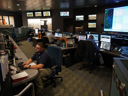 Jacob Kulhanek works inside DelDot's Transportation Management Center in Smyrna that oversees the state's roadways.