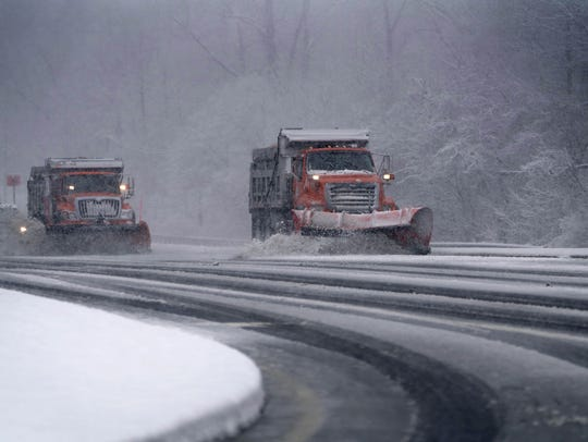 DelDOT plow trucks remove falling snow from Lancaster