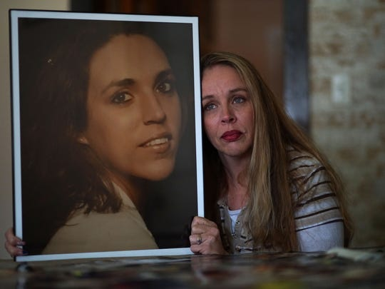 Crystal Waddell, of Northeast, Md., holds a picture of her 38-year-old sister Tammy, who died of a heroin overdose. Her family is trying to finds out the content of the heroin that killed her and where it came from.