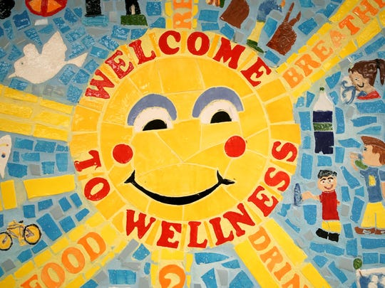 Students at Eisenberg Elementary School helped build a mural with health messages for the outside of the new Wellness Center in their school that offers free healthcare to students and family members at the school.