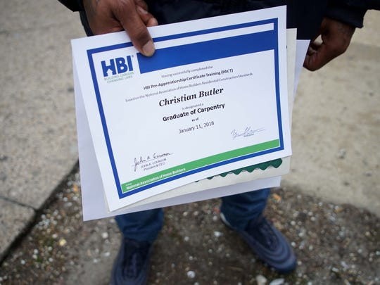 Christian Butler, a graduate of Interfaith Community Housing of Delaware's pre-apprentice construction program.