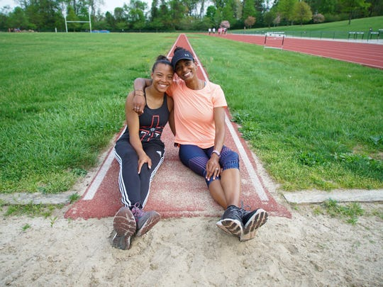 Kayla Woods, a 2018 Tatnall School graduate, with her Tatnall coach Lynn Hernandez, whose state long-jump record she broke last spring.