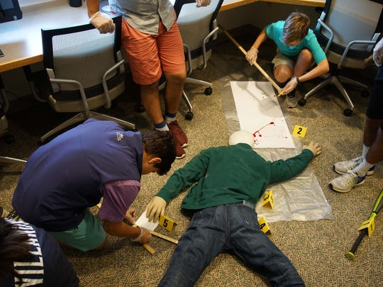Tower Hill students takes measurements in a mock crime scene for a Forensics course during Tower Term, a weeklong mini-term for Upper School students to explore learning together in an interdisciplinary, experiential way, allowing time for creative and dynamic programming that promotes deep engagement, critical thinking and real-life application.