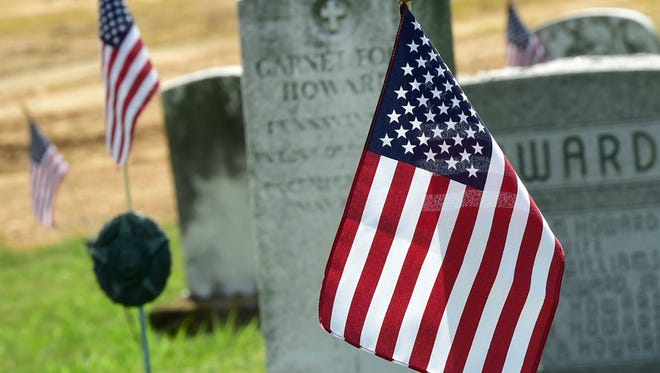 American flags are seen on the gravestones on Friday, May 27, 2016 at Mount Vernon/Lebanon Cemetery. The cemetery is known as Chambersburg's African American burial ground and many members of the United States Colored Troops were buried at the site. Monday is nationally recognized as Memorial Day.