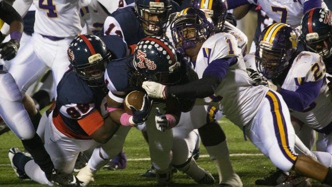 Damonta Kidd (1) of Columbus brings down South Panola's Demetrivs Market (1). South Panola hosts Madison Central while Columbus hosts Clinton in the first round of the Class 6A playoffs.