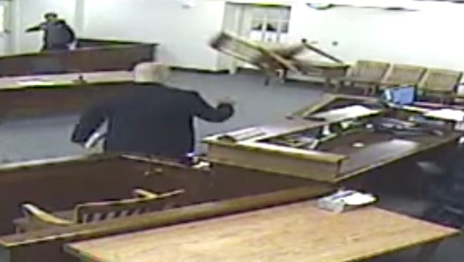 A chair is hurled across Bartholomew County courtroom.