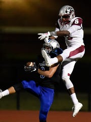 Nolensville cornerback Tim Coutras (8) intercepts a pass intended for Maplewood wide receiver Travares Springer during a game in 2017.