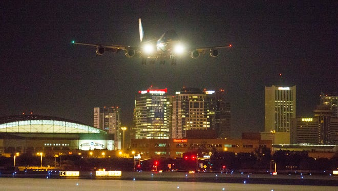 Air Force One approaches Phoenix Sky Harbor Airport Wednesday January 6, 2015. President Barack Obama announced a plan to make homeownership more affordable.