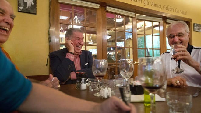 Jerry Colangelo enjoys dinner at Gattos Restaurant and Bar in Tinley Park, IL, with Orlando Pellegrino, right, and some of his closest friends on July 23,  2015.