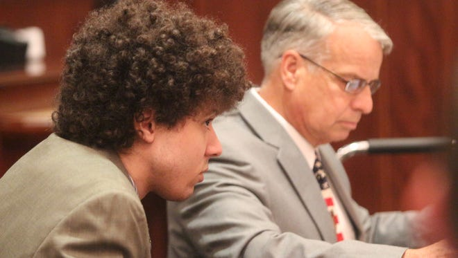 Joshua Black, left, waits for a jury to return with a verdict Wednesday with his attorney, Charles Bloodworth.