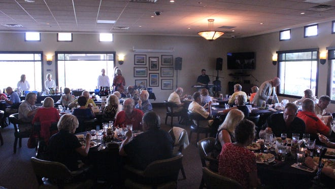 Residents attend a Kids for Sports Foundation winefest at Wolf Creek Golf Club.