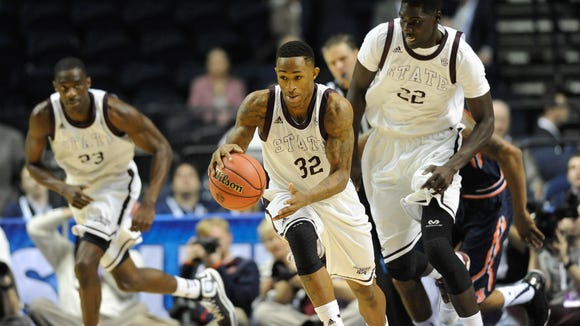 Mar 11, 2015; Nashville, TN, USA; Mississippi State Bulldogs guard Craig Sword (32) dribbles the ball against Auburn Tigers during the first half of the first round of the SEC Tournament at Bridgestone Arena. Mandatory Credit: Joshua Lindsey-USA TODAY Sports