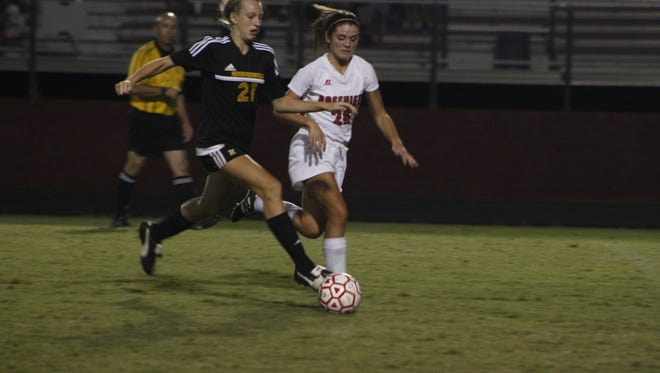 Rossview's Avery Sawyer tries to keep pace against a relentless Hendersonville offense Thursday night. Rossview  lost the game 3-1.