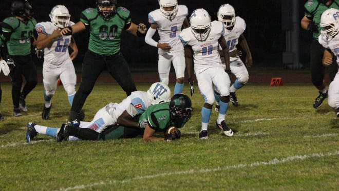 Bulldog Josh Bishop gets tackled by a Western player during a recent game.