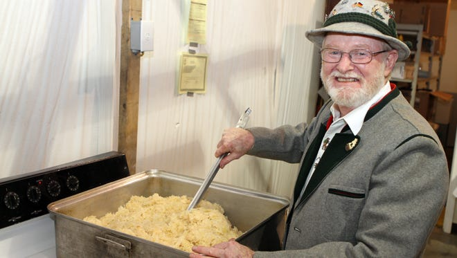 Roger Chism prepares traditional German style sauerkraut for an expected crowd of 1,000 people at the 35th Annual Oktoberfest hosted by the Clarksville Edelweiss Club this weekend at Clarksville Speedway.