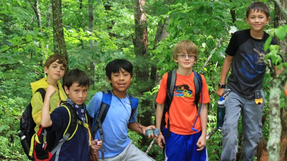Kids on a hike at the N.C. Arboretum in Asheville. The Arboretum and Asheville Outlets are hosting the Outdoor Fitness and Fun Fest this weekend.