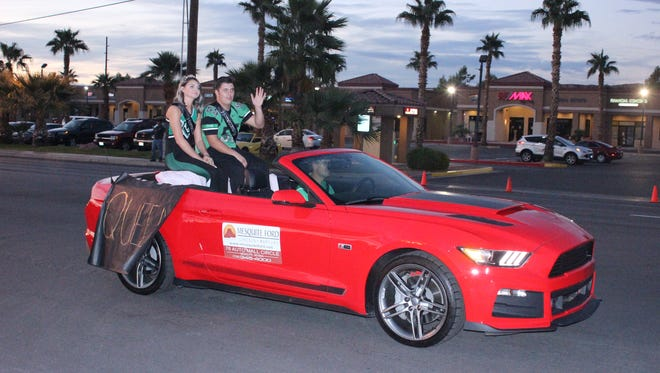 VVHS' Homecoming king and queen wave to the crowd during the Homecoming parade Thursday night.