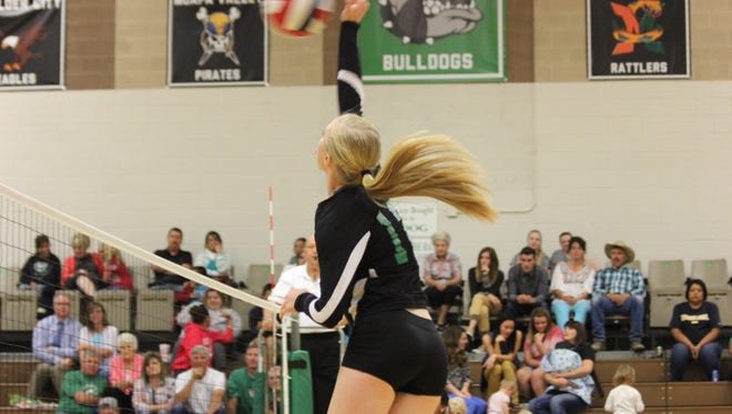 Lady Bulldog Emma Barnum spikes the ball during a set.