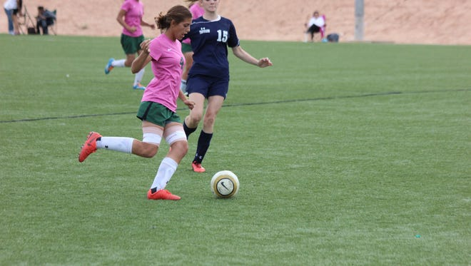 Lady Bulldog Taylor Waite dribbles the ball with a defender on her hip during a recent match in Mesquite. VVHS lost to Cheyenne in the first round of the South Division I-A playoffs last weel.