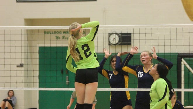 Lady Bulldog Emma Barnum goes up for a spike during a recent match against Boulder City at VVHS.