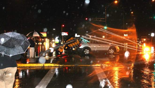 A traffic signal and street light fell on a car at the intersection of Central Avenue and McMillan Street in Marshfield on Tuesday. The southbound lanes of Central Avenue were blocked as a result of the incident.