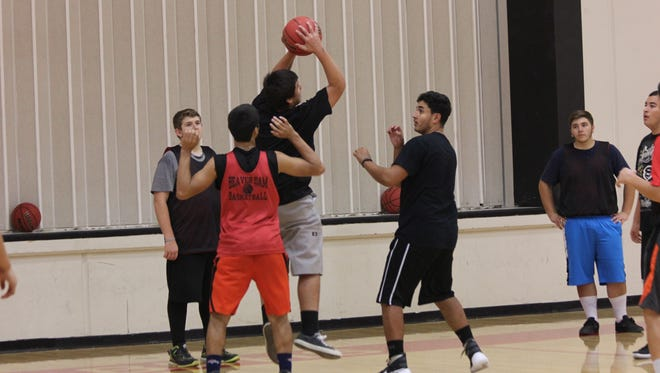 BDHS runs through a drill during tryouts Wednesday.