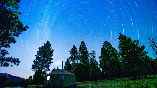 Stars illuminate the night sky over a back country yurt at the Flagstaff Nordic Center February 9, 2015.