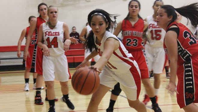 Beaver Dam's Jailene Hernandez reaches for a loose ball during a recent game against Sandy Valley.