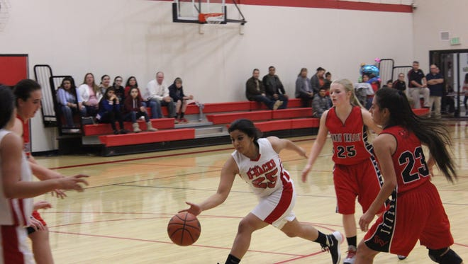 Maricela Sandoval of Beaver Dam gets off a pass after dribbling past two Sandy Valley defenders.