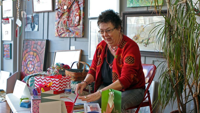 Peggy Bonnington getting ready for Saturday's Holiday Card Making: Recycling Workshop which takes place from 9:00 am - Noon at the Downtown Artist Co-op.