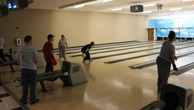 The Mesquite Special Olympics team practices its bowling at the Virgin River Casino bowling center.
